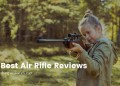 Young girl shooting an air rifle