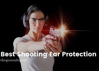 Woman firing a gun with protective gear