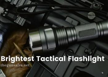 tactical flashlight resting on top of gun