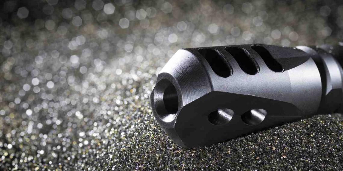 Black compensator for an AR-15 on dark sandblasting media