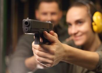woman holding a gun in a shooting range