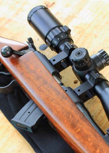 hunting rifle on table wooden