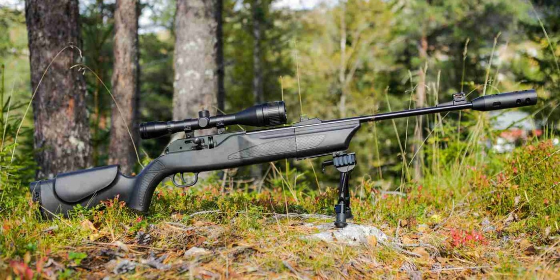 a stunning black rifle in the forest