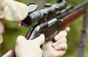 close up view of hunting rifles held by a hunter
