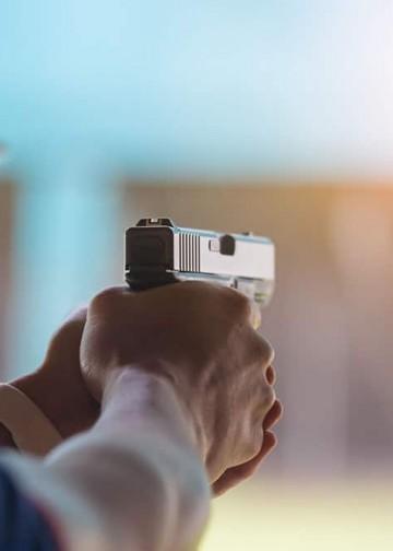 man shooting a pistol